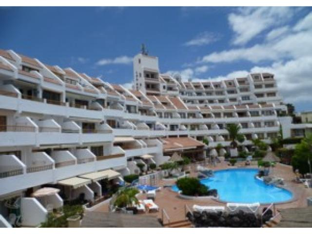 Looking back across the heated pool - Tenerife Apartments, San Eugenio, Tenerife